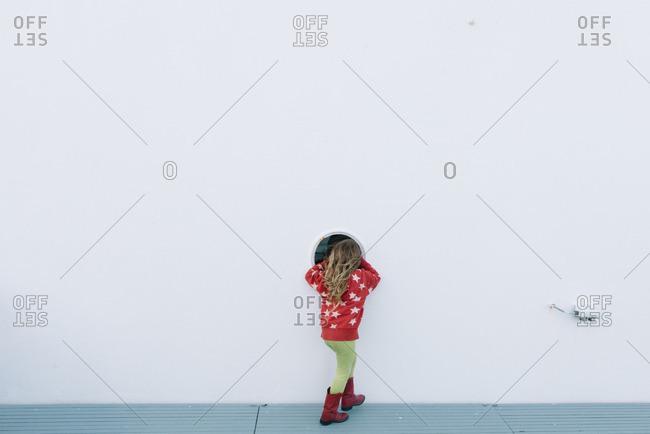 Girl looking in a ferry window