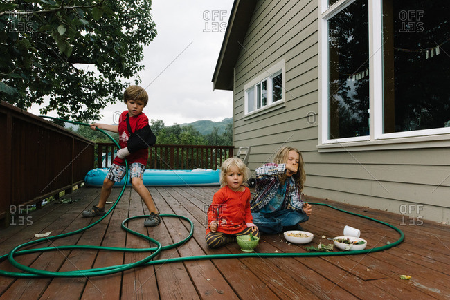 Kids hanging out on their deck