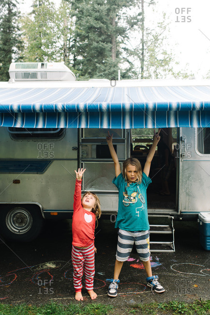 Kids underneath a camper awning