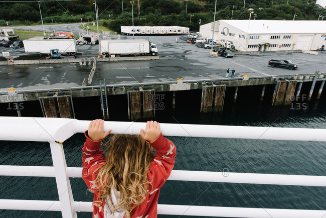 Girl on ferry looking at shore