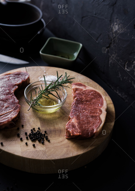 Raw sirloin steaks with seasonings