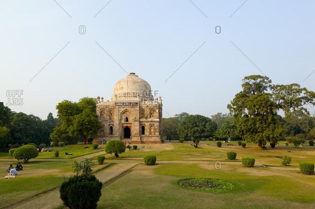 New Dehli, Dehli, India - November 27, 2009: Domed Sheesh Gumbad tomb and gardens