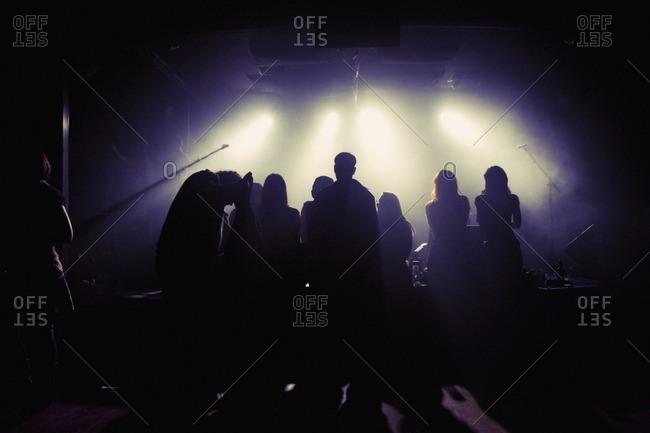 People socializing in nightclub - Offset