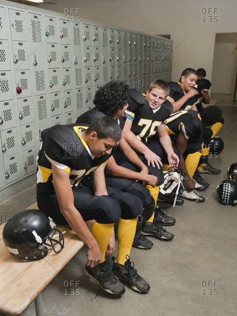Football players dressing in locker room