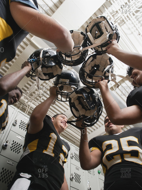 Football players celebrating in locker room