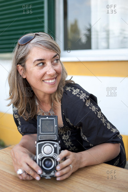 Caucasian woman holding old-fashioned camera
