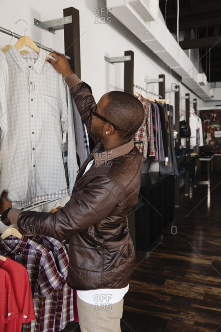 African American man shopping in clothing store