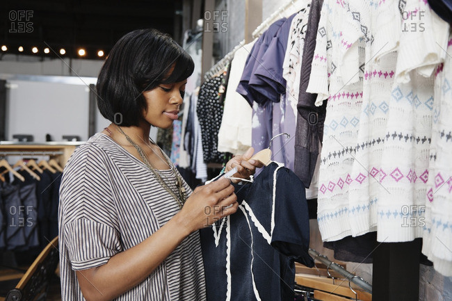 African American woman shopping in clothing store