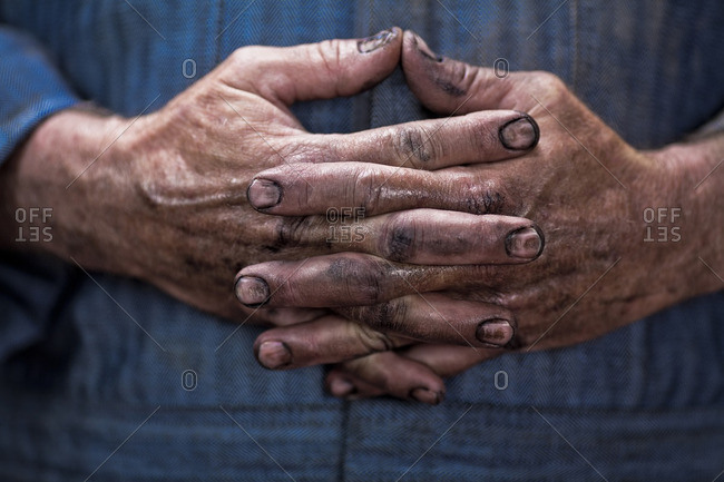 Close up of Caucasian mechanic's dirty hands