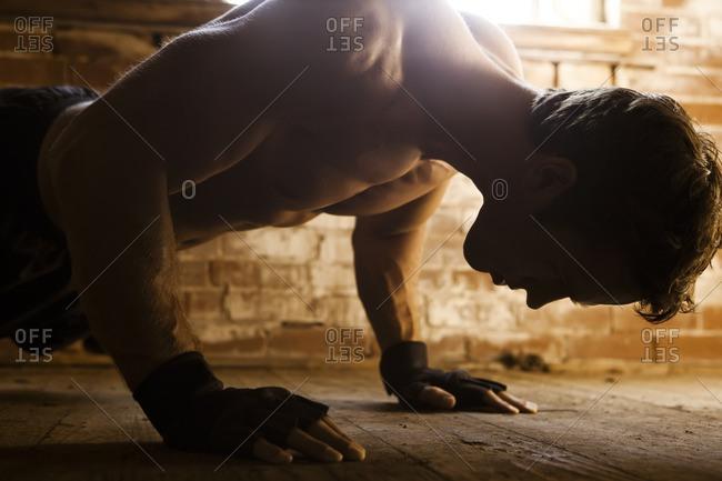 Caucasian man doing push-ups - Offset