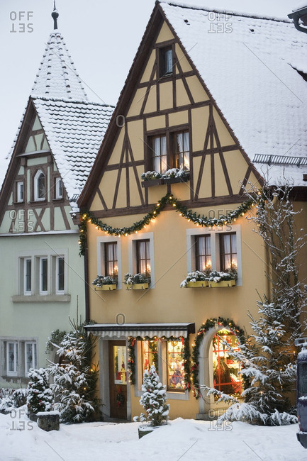 Quaint, snow covered village decorated for Christmas
