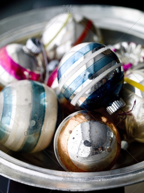 Old-fashioned Christmas ornaments in bowl