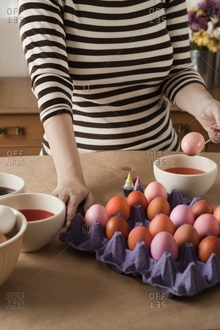 Woman dying Easter eggs
