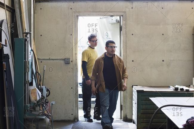 Workers entering factory door
