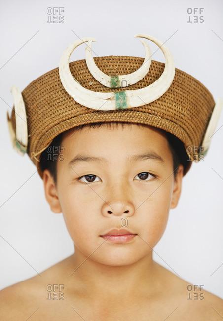 Serious boy in vintage warrior hat