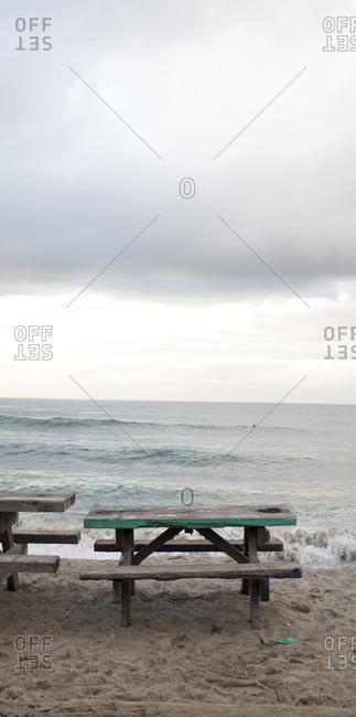 Picnic tables near ocean - Offset