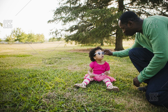Black father and daughter enjoying the park