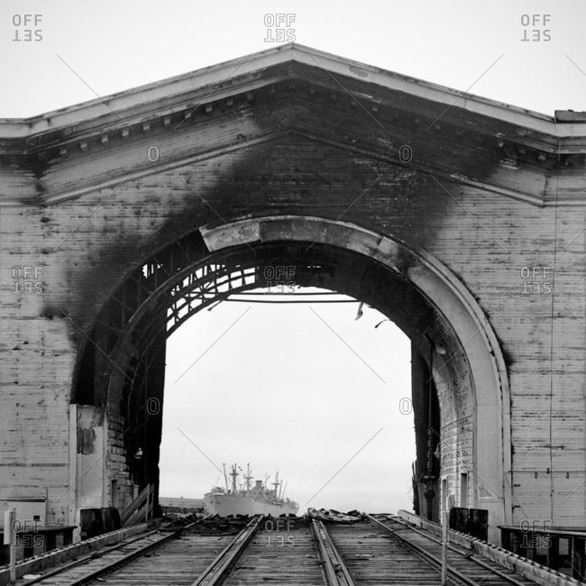 Burned arch over railroad tracks