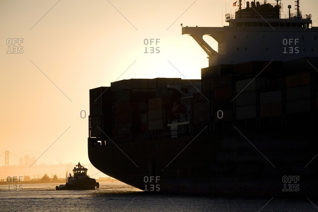 Tugboat and container ship in port of Oakland