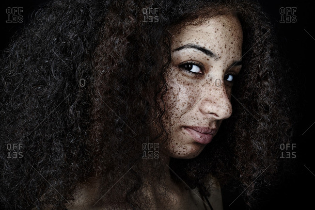 Freckled mixed race woman