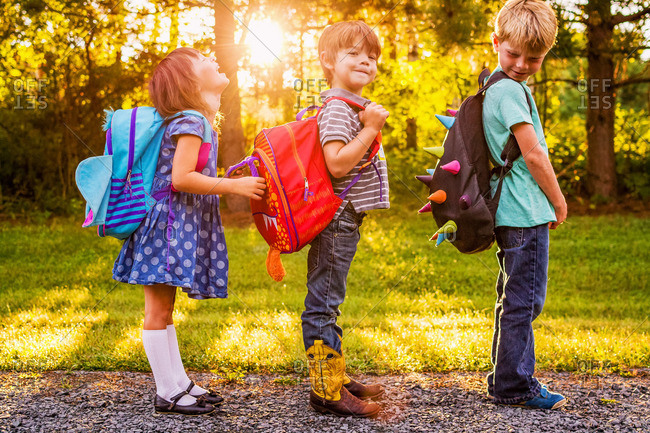 Three young children going to school