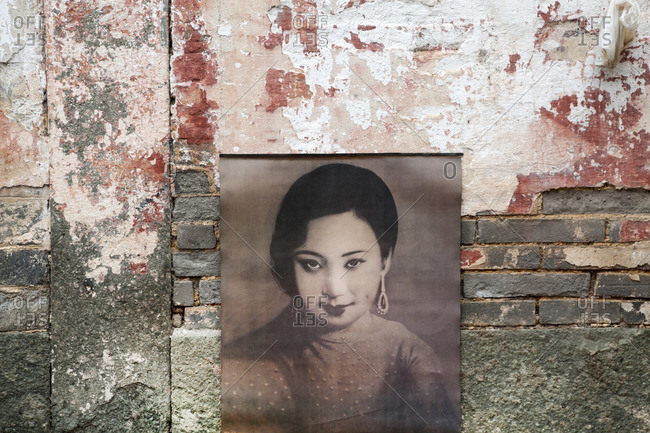 China, Beijing - October 19, 2016: An old advertisement for makeup on brick wall