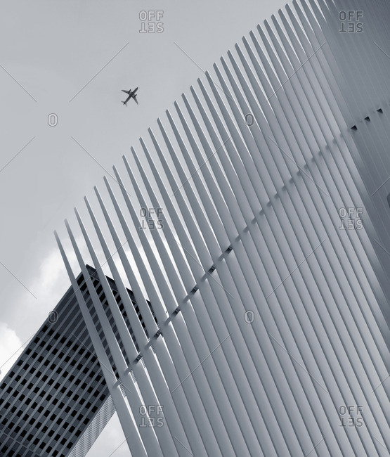 Architectural detail of subway station with plane in New York City