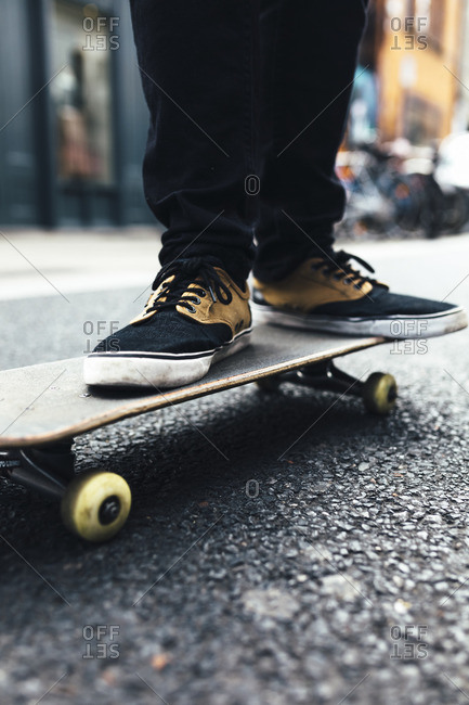 Young skateboarder on the street- partial view