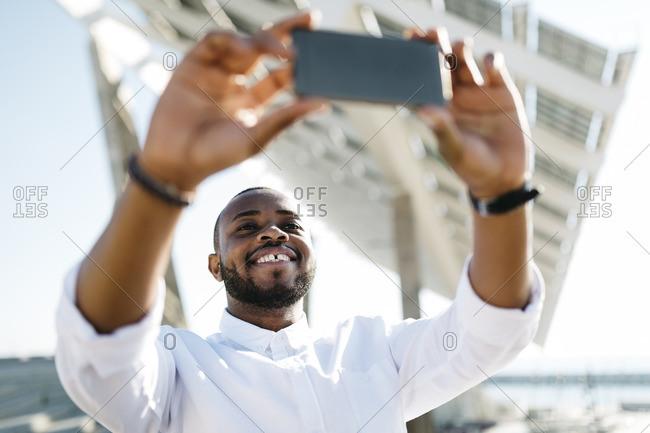 Man taking selfie outdoors