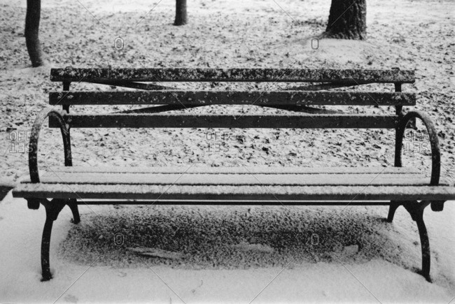 Park bench dusted with snow