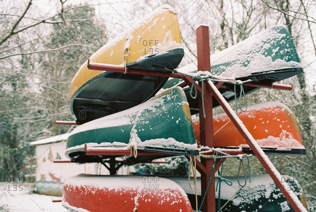 Canoes on a rack dusted in snow