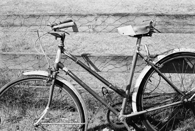Victoria, Canada - August 21, 2015: Antique bicycle leaning against an old fence