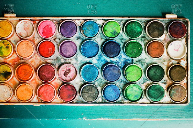 Messy tray of used watercolor paints