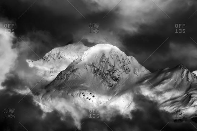 Mist enshrouds a nameless peak in the Chugach Mountains, Cordova, Alaska