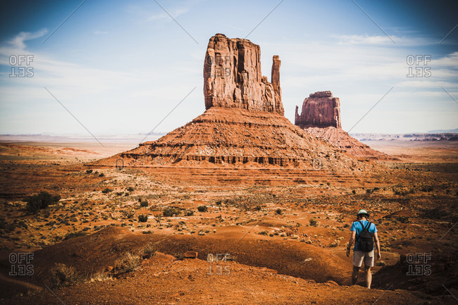 A hiker in Monument Valley