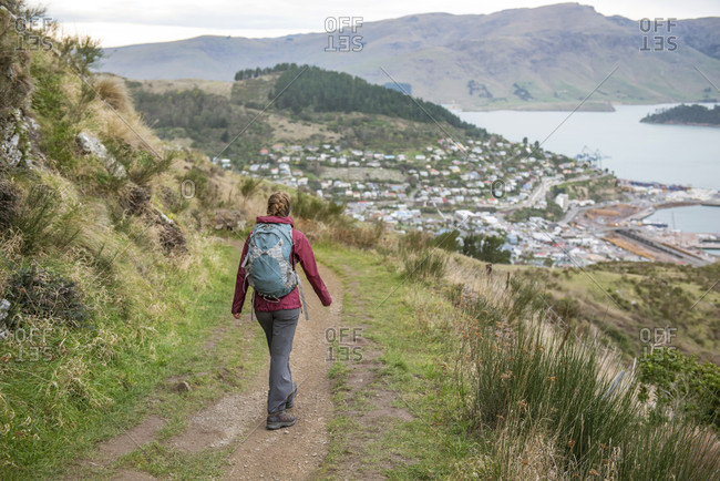 Woman walking on the bridal path trail toward Lyttelton Near Christchurch