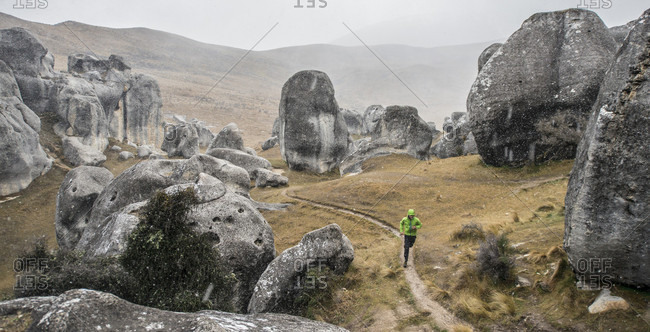 A man trail running at Castle Hill near Arthur's Pass outside of Christchurch New Zealand