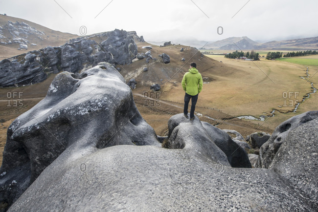 A man looks out at the view at Castle Hill near Arthur's Pass outside of Christchurch New Zealand