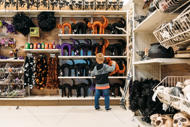 Boy selecting Halloween  decoration in big box store