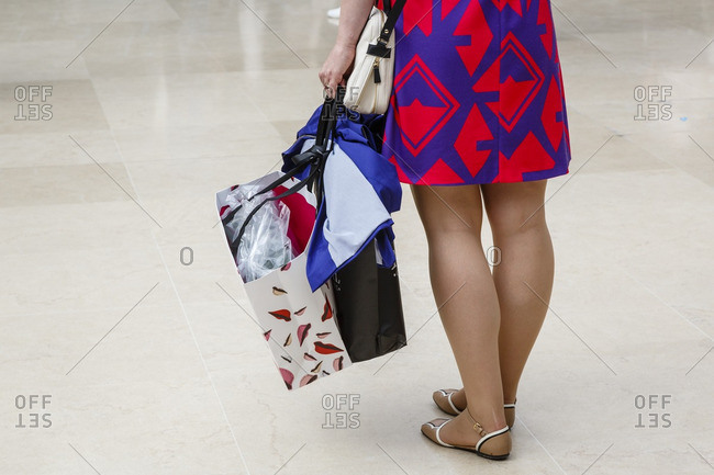 Woman with shopping bags, Paris, France