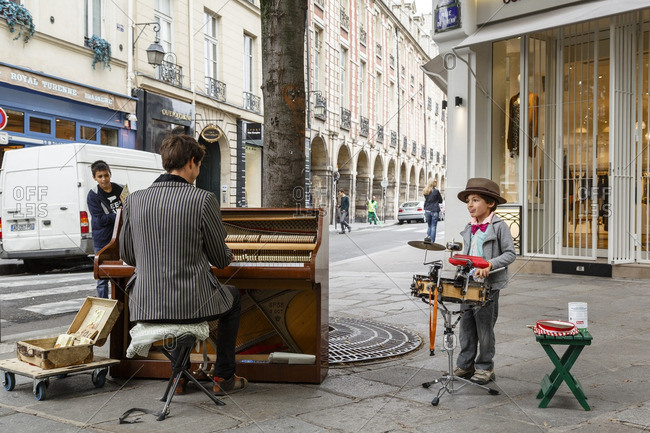 Paris, France - September 17, 2016: Street entertainers in Marais