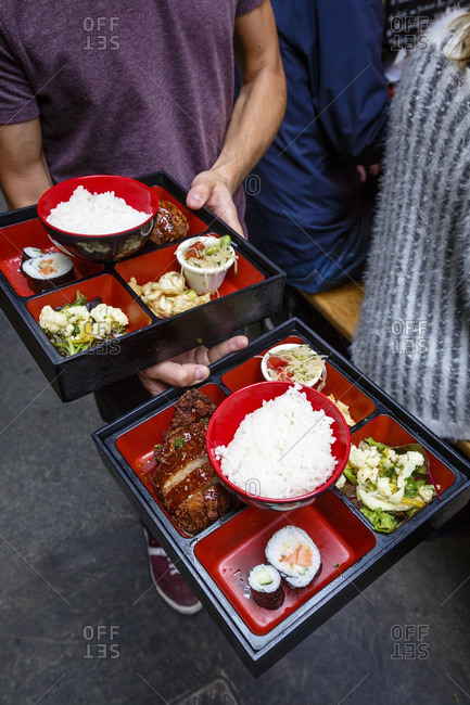 People with bento box lunches at Marche des Enfants Rouges, Marais, Paris, France