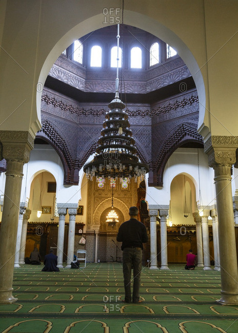 Man praying inside the Grande Mosquee de Paris, France