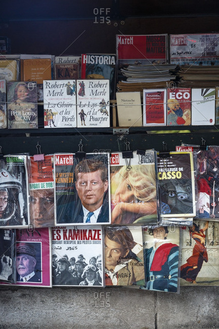 Paris, France - September 15, 2016: Vintage books and magazines for sale at a Les Bouquinistes book stall