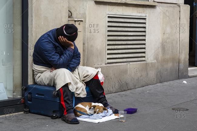Homeless man with dog Saint Germain, Paris