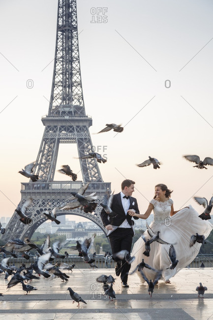 Paris, France - September 21, 2016: Couple taking wedding pictures in front of the Eiffel Tower