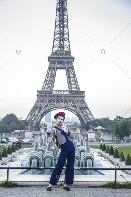 Paris, France - September 21, 2016:  Mime takes a selfie in front of the Eiffel Tower