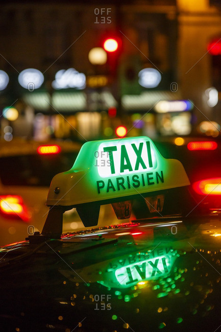 Lighted sign on taxi at night, Paris, France