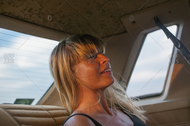 Sweden, Blonde woman on back seat of car