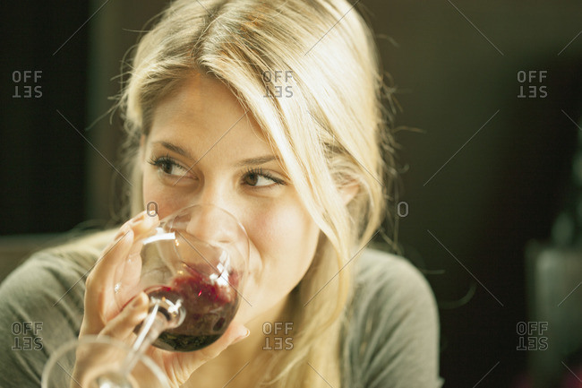 Sweden, Blonde woman drinking red wine